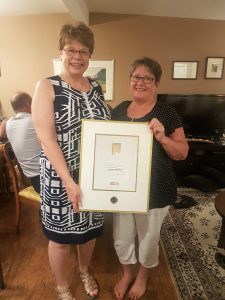 Heather Andrews receiving the Royal LePage President's Gold Award for sales in 2017